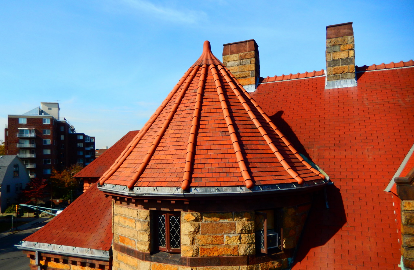 The newly restored turret roof is an in-kind, textbook example of proper historic preservation practices.