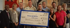 Members of RCASF's Fishing Tournament Committee donate $75,000 to Norm Wedderburn (far left), CEO and president, and Wanda Trouba (second from left), vice president, of the Make-a-Wish Foundation.