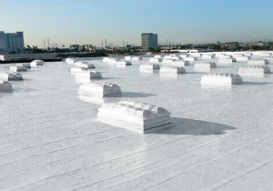The system was designed to meet California's Title 24 requirements and reduce thermal gain inside the building. The new roof installation included two plies of polyester reinforcement embedded in cold-applied asphalt emulsion, protected with white acrylic elastomeric surfacing. Photo courtesy of Highland Commercial Roofing.