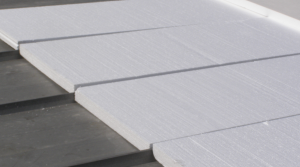 Flute fill insulation helps reduce labor costs on re-covers of standing seam metal roofs.