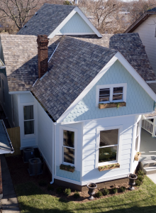 Karen E. Laine and Mina Starsiak believe since the roof is such a prominent exterior component, figuring out how it plays into the home's color palette is crucial. Their home in the Indianapolis area is shown here. Photo: Owens Corning.