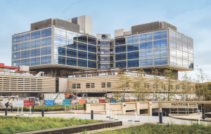 The new Stanford Hospital is currently under construction in Palo Alto, Calif. The 824,000-square-foot facility connects to the existing hospital by a bridge and tunnel. The project includes a multi-level parking garage and with additional office buildings. Photo: Stanford Health Center.