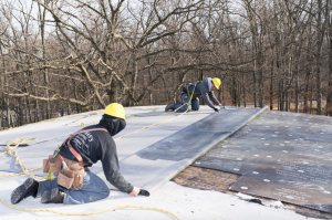 Crews from Bachman's Roofing, Building & Remodeling battled winter weather to install a new fully adhered EPDM roofing system from Mule-Hide Products Co.