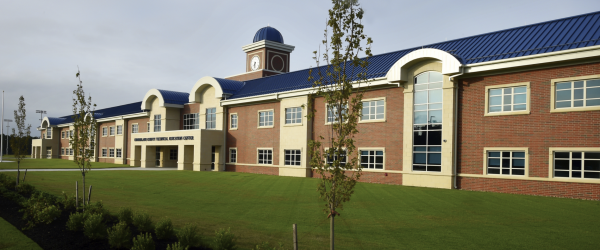 Design Combines Modified and Metal Roofs to Achieve Performance and Aesthetic Goals